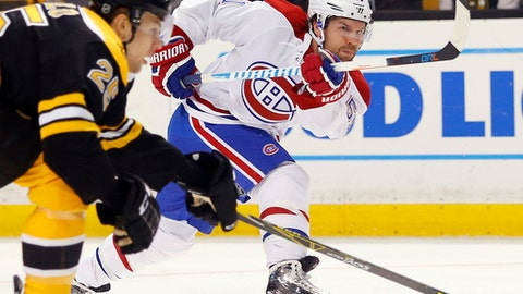 FILE - In this Oct. 22, 2016, file photo, Montreal Canadiens' David Desharnais follows through on a shot during the first period of an NHL hockey game against the Boston Bruins, in Boston. The New York Rangers have signed free-agent center David Desharnais to a one-year, $1 million contract. General manager Jeff Gorton announced the deal Wednesday, July 5, 2017. (AP Photo/Winslow Townson, FIle
