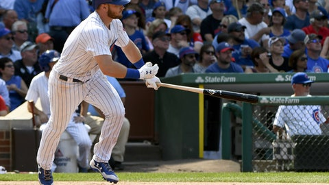 Chicago Cubs Ian Happ (8) hits a two-RBI single during the seventh inning of a baseball game against the Tampa Bay Rays on Wednesday, July 5, 2017, in Chicago. (AP Photo/Matt Marton)