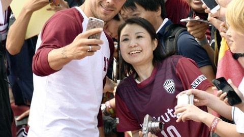 Germany's Lukas Podolski takes a photo with a fan during a welcoming ceremony in Kobe, western Japan Thursday, July 6, 2017. Podolski will play for Japanese club Vissel Kobe. (Tsuyoshi Ueda/Kyodo News via AP)