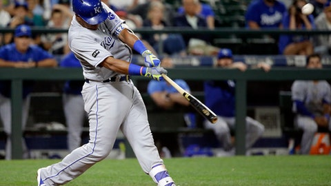 Kansas City Royals' Salvador Perez hits a two-run home run against the Seattle Mariners in the 10th inning of a baseball game Wednesday, July 5, 2017, in Seattle. (AP Photo/Elaine Thompson)