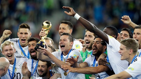 FILE - In this Sunday July 2, 2017 file photo, Germany's Julian Draxler holds the trophy after winning the Confederations Cup final soccer match between Chile and Germany, at the St. Petersburg Stadium, Russia. Germany leads the FIFA rankings again after the 2014 World Cup winner added the Confederations Cup title on Sunday. (AP Photo/Thanassis Stavrakis, File)