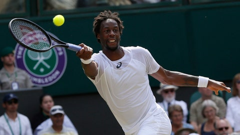 Gael Monfils of France returns the ball to Britain's Kyle Edmund during their Men's Singles Match on day four at the Wimbledon Tennis Championships in London Thursday, July 6, 2017. (AP Photo/Kirsty Wigglesworth)