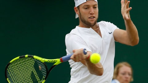 Jack Sock of the United States returns to Austria's Sebastian Ofner during their Men's Singles Match on day four at the Wimbledon Tennis Championships in London Thursday, July 6, 2017. (AP Photo/Alastair Grant)