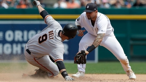 San Francisco Giants' Brandon Belt safely slides ahead of the tag by Detroit Tigers third baseman Nicholas Castellanos for a double during the sixth inning of a baseball game, Thursday, July 6, 2017, in Detroit. (AP Photo/Carlos Osorio)