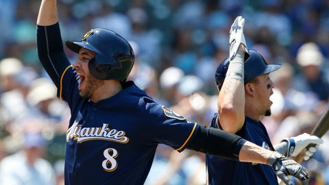 Milwaukee Brewers' Ryan Braun, left, celebrates with Hernan Perez after hitting a two-run home run against the Chicago Cubs during the third inning of a baseball game Thursday, July 6, 2017, in Chicago. (AP Photo/Nam Y. Huh)