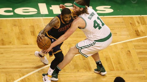 BOSTON, MA - MAY 25:  Kyrie Irving #2 of the Cleveland Cavaliers handles the ball against Kelly Olynyk #41 of the Boston Celtics in the first half during Game Five of the 2017 NBA Eastern Conference Finals at TD Garden on May 25, 2017 in Boston, Massachusetts. NOTE TO USER: User expressly acknowledges and agrees that, by downloading and or using this photograph, User is consenting to the terms and conditions of the Getty Images License Agreement.  (Photo by Adam Glanzman/Getty Images)