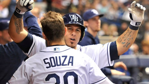 Tampa Bay Rays' Wilson Ramos, right, celebrates his two-run home run with Steven Souza Jr. (20) in the dugout during the sixth inning of the team's baseball game against the Boston Red Sox on Thursday, July 6, 2017, in St. Petersburg, Fla. (AP Photo/Steve Nesius)