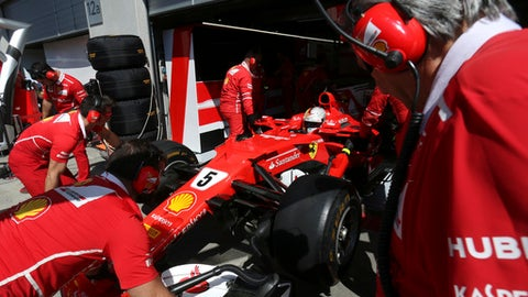 Ferrari mechanics push the race car of driver Sebastian Vettel of Germany back into the team box during the first practice session for the Austrian Formula One Grand Prix at the Red Bull Ring in Spielberg, Austria, Friday, July 7, 2017. The Austrian Grand Prix will be held on Sunday. (AP Photo/Ronald Zak)