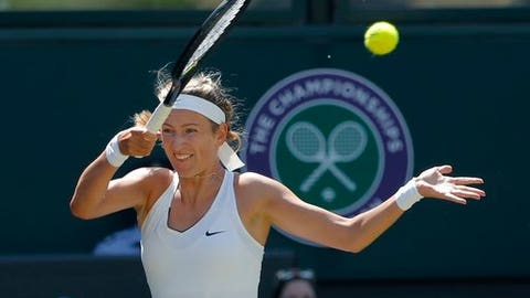 Victoria Azarenka of Belarus returns to Britain's Heather Watson during their Women's Singles Match on day five at the Wimbledon Tennis Championships in London Friday, July 7, 2017. (AP Photo/Alastair Grant)
