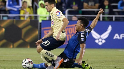 FILE - In this July 14, 2015, file photo, San Jose Earthquakes midfielder Matheus Silva, right, challenges Club America forward Alejandro Diaz (30) for the ball during the second half of an International Champions Cup soccer match in San Jose, Calif. The Earthquakes say Silva has emerged from a coma, two days after the Brazilian defender was rescued from Lake Tahoe. Silva, who was playing this season for Reno 1868 FC, struggled while swimming at a Fourth of July gathering. He was pulled from the water by teammates and bystanders but was unresponsive and did not have a pulse. (AP Photo/Jeff Chiu, File)