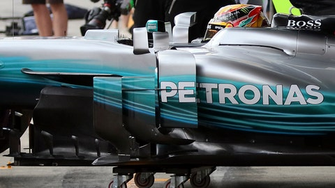 The Mercedes race car of driver Lewis Hamilton of Britain is pushed into the team box during the second practice session for the Austrian Formula One Grand Prix at the Red Bull Ring in Spielberg, Austria, Friday, July 7, 2017. The Austrian Grand Prix will be held on Sunday. (AP Photo/Ronald Zak)