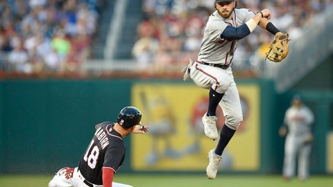 Washington Nationals' Ryan Raburn (18) is out at second as Atlanta Braves shortstop Dansby Swanson, right, follows through on a throw to first to get out Bryce Harper during the fourth inning of a baseball game, Friday, July 7, 2017, in Washington. (AP Photo/Nick Wass)