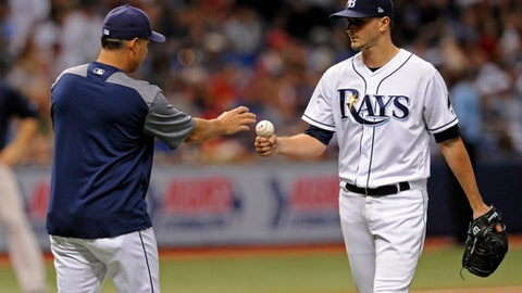 Tampa Bay Rays manager Kevin Cash, left, pulls starter Jake Odorizzi after Odorizzi allowed a bases-loaded walk to Boston Red Sox's Jackie Bradley Jr. during the fifth inning of a baseball game Friday, July 7, 2017, in St. Petersburg, Fla. (AP Photo/Steve Nesius)