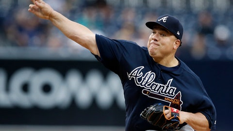 FILE - In this June 28, 2017, file photo, Atlanta Braves starting pitcher Bartolo Colon throws during the first inning of the team's baseball game against the San Diego Padres in San Diego. Colon has agreed to terms on a minor league deal with the Minnesota Twins. The 44-year-old with 235 career victories was designated for assignment last Thursday by the Braves, a day after a loss to San Diego dropped his record to 2-8. He had an 8.14 ERA in 13 starts. The Twins say Colon will report to Triple-A Rochester soon. The announcement was made in the third inning of Minnesota's game Friday against Baltimore. (AP Photo/Alex Gallardo, File)
