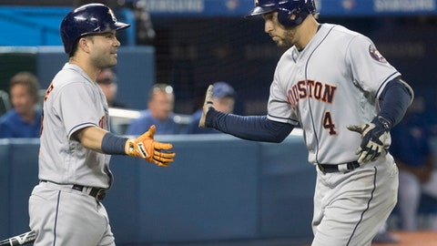 Houston Astros' George Springer, right, is greeted by Jose Altuve after hitting his second home run of the night against the Toronto Blue Jays, during the seventh inning of a baseball game Friday, July 7, 2017, in Toronto. (Fred Thornhill/The Canadian Press via AP)