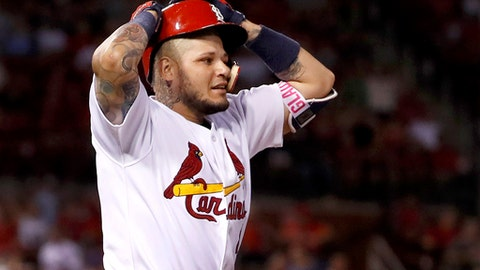 St. Louis Cardinals' Yadier Molina reacts after lining out to end the eighth inning of a baseball game against the New York Mets, Friday, July 7, 2017, in St. Louis. (AP Photo/Jeff Roberson)