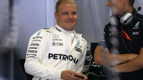 Mercedes driver Valtteri Bottas of Finland smiles in the team box before the third practice session for the Austrian Formula One Grand Prix at the Red Bull Ring in Spielberg, Austria, Saturday, July 8, 2017. The Austrian Grand Prix will be held on Sunday. (AP Photo/Ronald Zak)