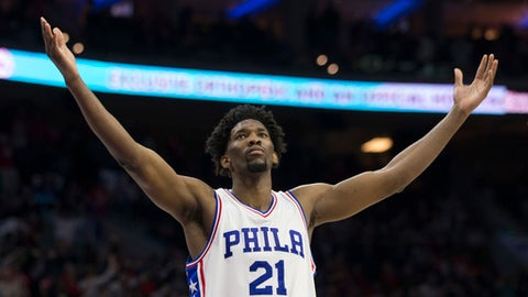 PHILADELPHIA, PA - JANUARY 27: Joel Embiid #21 of the Philadelphia 76ers reacts after a made basket against the Houston Rockets at the Wells Fargo Center on January 27, 2017 in Philadelphia, Pennsylvania. NOTE TO USER: User expressly acknowledges and agrees that, by downloading and or using this photograph, User is consenting to the terms and conditions of the Getty Images License Agreement. (Photo by Mitchell Leff/Getty Images)