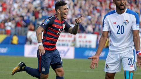 CORRECTS SPELLING TO DWYER, INSTEAD OF DYWER - United States' Dom Dwyer (14) celebrates after scoring a goal as Panama's Anibal Godoy (20) reacts during a CONCACAF Gold Cup soccer match Saturday, July 8, 2017, in Nashville, Tenn. (AP Photo/Mark Humphrey)