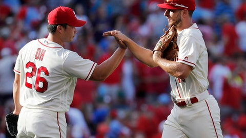 St. Louis Cardinals' Paul DeJong, right, and relief pitcher Seung-Hwan Oh celebrate following a baseball game against the New York Mets, Saturday, July 8, 2017, in St. Louis. The Cardinals won 4-1. (AP Photo/Jeff Roberson)