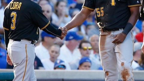 Pittsburgh Pirates' Josh Bell, right, celebrates with third base coach Joey Cora after passed ball by Chicago Cubs catcher Willson Contreras during the fourth inning of a baseball game Saturday, July 8, 2017, in Chicago. (AP Photo/Nam Y. Huh)