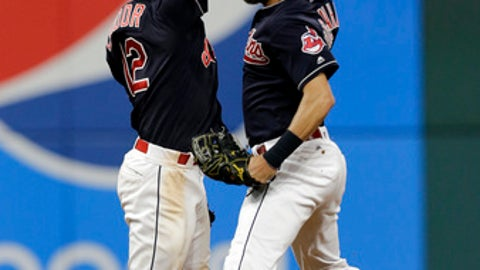 iCleveland Indians' Lonnie Chisenhall, right, and Francisco Lindor celebrate after the Indians defeated the Detroit Tigers 4-0 in a baseball game, Saturday, July 8, 2017, in Cleveland. (AP Photo/Tony Dejak)