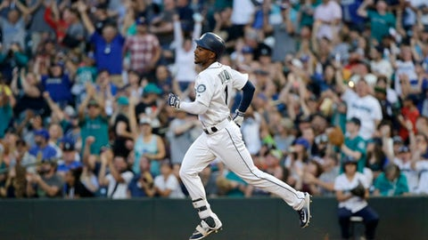 Seattle Mariners' Jarrod Dyson rounds the bases after hitting a solo home run off Oakland Athletics' Chris Smith during the fifth inning of a baseball game, Saturday, July 8, 2017, in Seattle. (AP Photo/John Froschauer)
