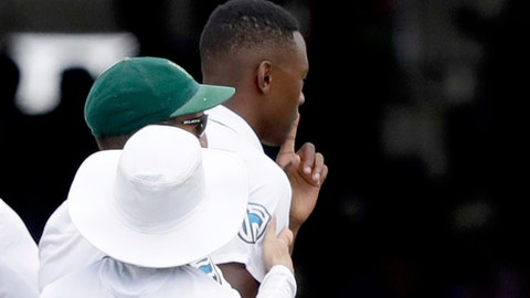 South Africa's Kagiso Rabada puts his finger up to his mouth as he celebrates taking the wicket of England's Ben Stokes LBW during the first test between England and South Africa at Lord's cricket ground in London, Sunday, July 9, 2017. In the previous innings microphones picked up Radaba using inappropriate language when he also took the wicket of Ben Stokes, leading to him being suspended for the next test match in the series. (AP Photo/Matt Dunham)