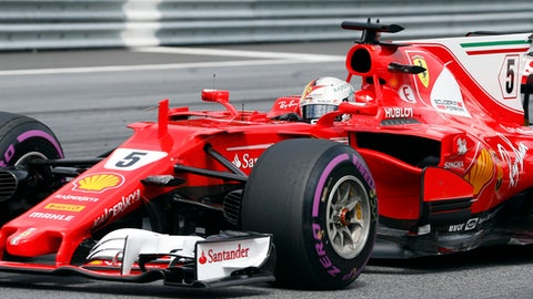 Ferrari driver Sebastian Vettel of Germany steers his car during the Austrian Formula One Grand Prix at the Red Bull Ring in Spielberg, Austria, Sunday, July 9, 2017. (AP Photo/Darko Bandic)