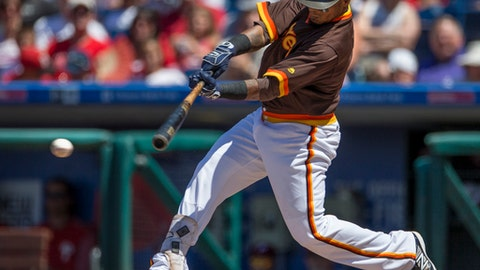 San Diego Padres' Erick Aybar hits a single in the fourth inning of a baseball game against the Philadelphia Phillies, Sunday, July 9, 2017, in Philadelphia. (AP Photo/Laurence Kesterson)