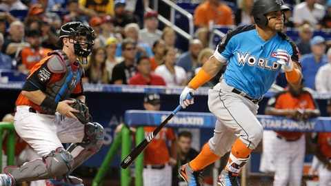 World Team's Yoan Moncada, right, of the Chicago White Sox, bats during the first inning of the All-Star Futures baseball game, Sunday, July 9, 2017, in Miami. U.S. Team catcher Chance Sisco, left, of the Baltimore Orioles. looks on. (AP Photo/Lynne Sladky)