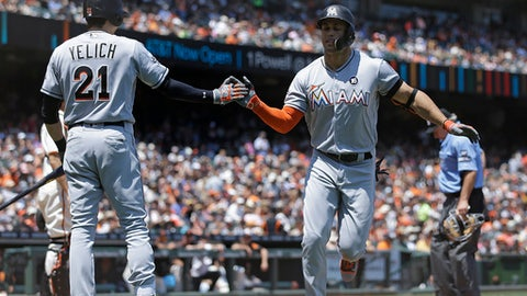 Miami Marlins' Giancarlo Stanton, right, is congratulated by Christian Yelich (21) after hitting a home run off San Francisco Giants' Johnny Cueto in the fifth inning of a baseball game, Sunday, July 9, 2017, in San Francisco. (AP Photo/Ben Margot)