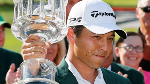 Xander Schauffele hoists the winners trophy after winning the Greenbrier Classic PGA Tour golf tournament, Sunday, July 9, 2017, in White Sulphur Springs, W.Va. (AP Photo/Steve Helber)