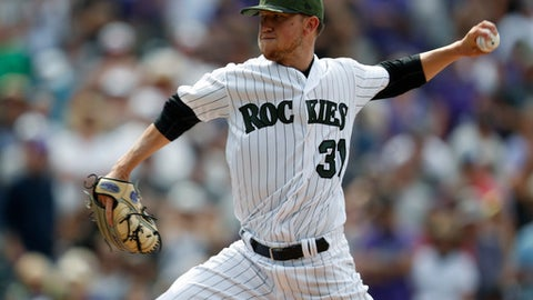 Colorado Rockies starting pitcher Kyle Freeland delivers a pitch to Chicago White Sox' Adam Engel in the ninth inning of a baseball game, Sunday, July 9, 2017, in Denver. The Rockies won 10-0. (AP Photo/David Zalubowski)