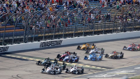 Will Power, of Australia, leads the field at the start of an IndyCar Series auto race Sunday, July 9, 2017, at Iowa Speedway in Newton, Iowa. (AP Photo/Charlie Neibergall)