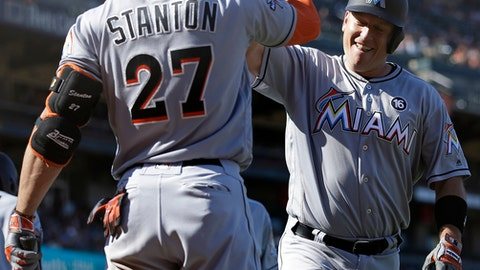 Miami Marlins' A.J. Ellis, right, celebrates with Giancarlo Stanton (27) after hitting a two run home run off San Francisco Giants' George Kontos in the eleventh inning of a baseball game Sunday, July 9, 2017, in San Francisco. (AP Photo/Ben Margot)