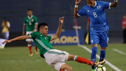 Mexico's Edson Alvarez, left, and El Salvador's Denis Pineda fight for the ball during a CONCACAF Gold Cup soccer match in San Diego, Sunday, July 9, 2017. (AP Photo/Gregory Bull)