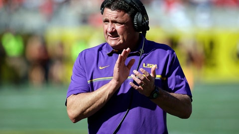 FILE - In this Dec. 31, 2016, file photo, LSU coach Ed Orgeron encourages players during the second half of the Citrus Bowl NCAA football game against Louisville in Orlando, Fla. Orgeron will be one of the coaches to take the podium Monday, July 10, 2017, at the SEC media days in suburban Birmingham, Ala. (AP Photo/John Raoux, File)