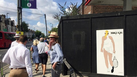People walk past an artwork by London based street artist 'Fussy Human' near Southfields tube station Monday July 10, 2017. The artwork is a take on a famous poster of the 1970's and was displayed a short walk from the venue of the Wimbledon tennis championships. (AP Photo/Tony Hicks)
