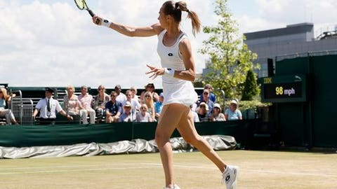 Slovakia's Magdalena Rybarikova returns to Croatia's Petra Martic during their Women's Singles Match on day seven at the Wimbledon Tennis Championships in London Monday, July 10, 2017. (AP Photo/Kirsty Wigglesworth)