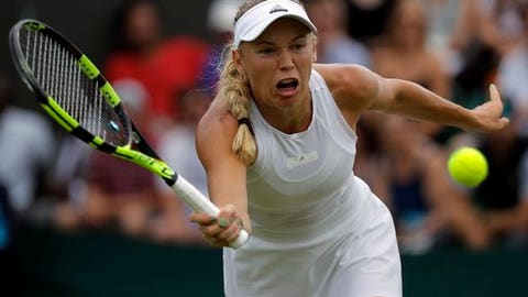 Denmark's Caroline Wozniacki returns to Coco Vandeweghe of the United States during their Women's Singles Match on day seven at the Wimbledon Tennis Championships in London Monday, July 10, 2017. (AP Photo/Alastair Grant)