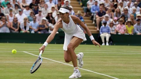 Spain's Garbine Muguruza returns to Germany's Angelique Kerber during their Women's Singles Match on day seven at the Wimbledon Tennis Championships in London Monday, July 10, 2017. (AP Photo/Tim Ireland)