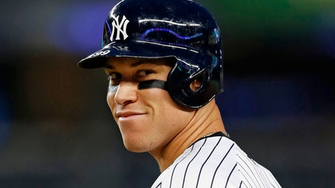 FILE - In this May 23, 2017, file photo, New York Yankees Aaron Judge reacts after drawing a walk in a baseball game against the Kansas City Royals at Yankee Stadium in New York. This time last year, Aaron Judge had played exactly zero big-league games. The New York Yankees' rookie slugger is now an All-Star and MVP hopeful. Big things are happening for one of baseball's biggest men. (AP Photo/Kathy Willens, File)