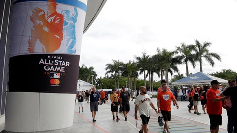 Fans arrive for the All-Star Home Run Derby, Monday, July 10, 2017, in Miami. (AP Photo/Lynne Sladky)
