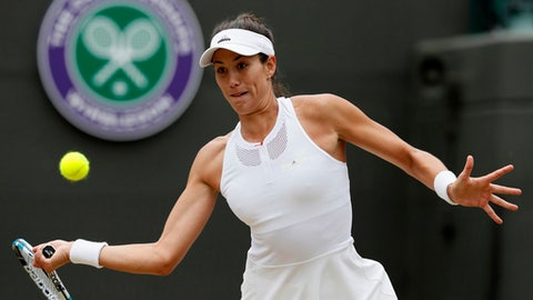 Spain's Garbine Muguruza returns to Russia's Svetlana Kuznetsova during their Women's Quarterfinal Singles Match on day eight at the Wimbledon Tennis Championships in London Tuesday, July 11, 2017. (AP Photo/Kirsty Wigglesworth)