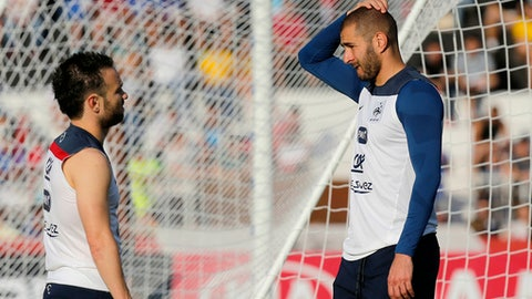 FILE - In this June 10, 2014 file photo, France's Mathieu Valbuena, left, and Karim Benzema, right, chat during a training session of the french national soccer team, at the Santa Cruz Stadium in Ribeirao Preto, Brazil. France's highest court has ruled Tuesday July 11, 2017 in favor of Real Madrid forward Benzema in a blackmail case linked to a sex tape involving his France teammate Valbuena, saying the investigation against the French striker was unfair. (AP Photo/David Vincent, File)