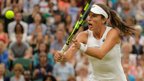 Britain's Johanna Konta returns to Romania's Simona Halep during their Women's Quarterfinal Singles Match on day eight at the Wimbledon Tennis Championships in London, Tuesday, July 11, 2017. (AP Photo/Alastair Grant)