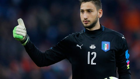 FILE- In this Tuesday, March 28, 2017 file photo, Italy's new goalkeeper Gianluigi Donnarumma gestures during the international friendly soccer match between The Netherlands and Italy at the Amsterdam ArenA stadium, Netherlands. AC Milan's teenage goalkeeper Gianluigi Donnarumma has agreed to extend his contract with the Serie A club until 2021, it was reported on Tuesday, July 11, 2017. (AP Photo/Peter Dejong, File)