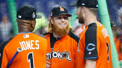 National League's Gary Jones (1), of the Chicago Cubs, left, talks with Los Angeles Dodgers Justin Turner (10) and Cincinnati Reds Zack Cozart (2), prior to the MLB baseball All-Star Game, Tuesday, July 11, 2017, in Miami. (AP Photo/Wilfredo Lee)