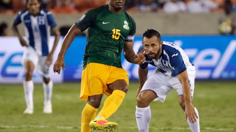 French Guiana midfielder Florent Malouda (15) controls the ball in front of Honduras midfielder Alfredo Mejia (8) in the first half of a CONCACAF Gold Cup soccer match in Houston, Tuesday, July 11, 2017. (AP Photo/David J. Phillip)